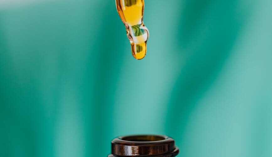 brown glass bottle with liquid and pipette